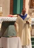 Fr. Goyette blesses the jewels of office.