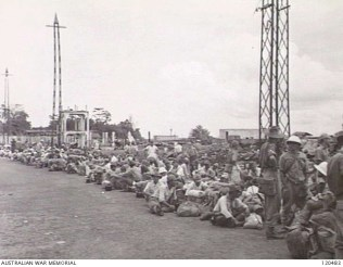 120483 Sandakan Japanese Civilians and Naval Personnel waiting to board landing ships 1945