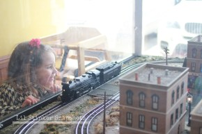 A mini town and train model on display