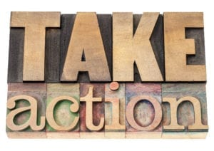 "Improve Dental Front Office Efficiency When You Take Action. A wooden sign says ""Take Action"""