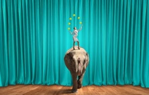 Improve Dental Front Office Efficiency With Some Training. A Young Businesswoman stands on an elephant juggling balls.