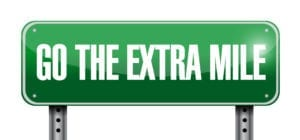 Go The Extra Mile Sign Represents All The Efforts Needed in Working Overdue Patient Accounts