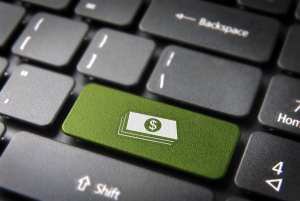 A green key on a keyboard with a dollar sign shows why patient aging reports are important to the dental office.