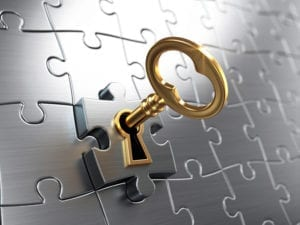 A key in a puzzle piece demonstrates how important dental office phone training is to the dental practice.
