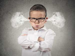 An angry young boy has steam blowing out his ears. Anger is one emotion often displayed in difficult dental patient situations.