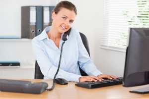 Focus on the patient when answering dental office phones.