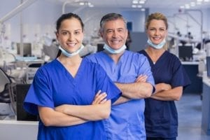 Dental office assistants and dentists too are part of a good team huddle.