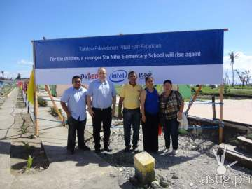 Intel Philippines Country Manager Calum Chisholm (2nd from left) joins members of the Sto. Niño Elementary School administration at the reconstruction site in Tanuan, Leyte. Intel, together with the Department of Education and the Philippine Busines for Social Progress, will help restore normalcy in the academic system by rehabilitating school buildings.