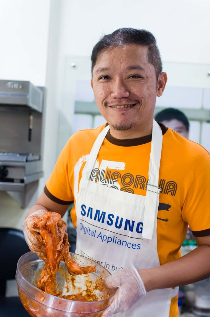 Jonel Uy (joneluy.com) prepares his chicken by covering it in marinade