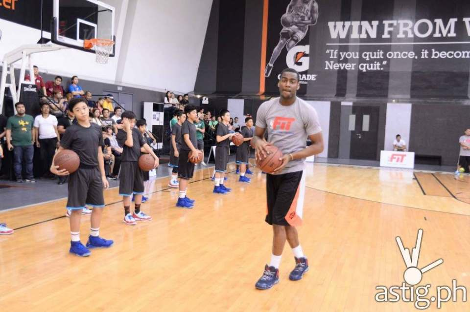 Utah Jazz shooting guard Alec Burks showing the participants how its done
