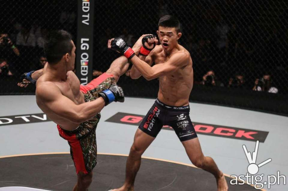 """Singapore's Christian """"The Warrior"""" Lee continues his meteoric rise through the ranks with his fourth straight stoppage victory, turning in a sensational performance against the Philippines' Cary """"The Prince"""" Bullos to win by submission"""