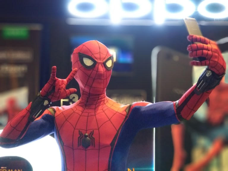 Cosplayer Dranzerdice as Spiderman taking a selfie with the OPPO F3 black edition
