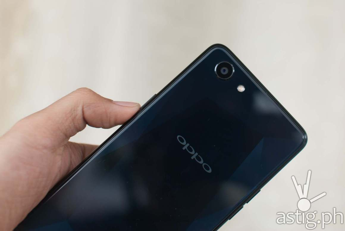 OPPO F7 Youth rear handheld showing camera