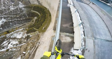Biker Balances on Handrail Above 600ft Dam