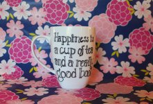 "2. ""Happiness is a cup of tea and a really good book"""