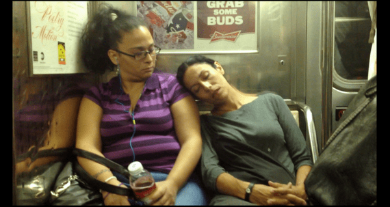 person sleeping on the subway