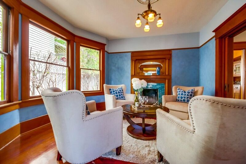 Living room staging with wooden and blue accents