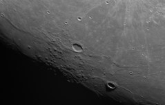 Volcanic domes on the moons surface-and Marius impact crater in the center