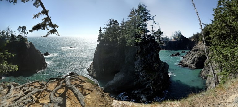 Natural Bridge-Panorama of as far out as I dared to scoot my bottom on the point covered with tree roots, so windy felt I would get blown off and down the cliffs:)