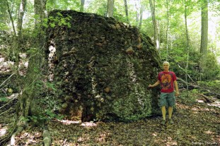 """This giant boulder is a type of rock called conglomerate. It was formed over a billion years ago. Fast moving water picked up and carried the pebbles that you can see inside the rock, rounding them as they travelled. Where they were deposited into big piles they were """"glued"""" together and formed solid rock-Isn't nature grand!"""