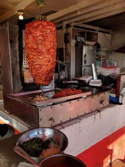 El Rey del Taco-Tacos al pastor-roasted prok with pineapple juices dripping down..12 peso a tcos, about $0.75