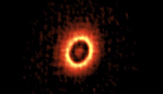 Citra DM Tau dan dua cincin konsentriknya dimana planet bisa saja terbentuk. Kredit: ALMA (ESO/NAOJ/NRAO), Kudo et al.
