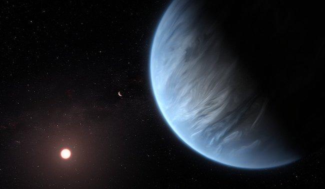 Ilustrasi eksoplanet K2-18b yang memiliki uap air di atmosfernya. Kredit: ESA/NASA
