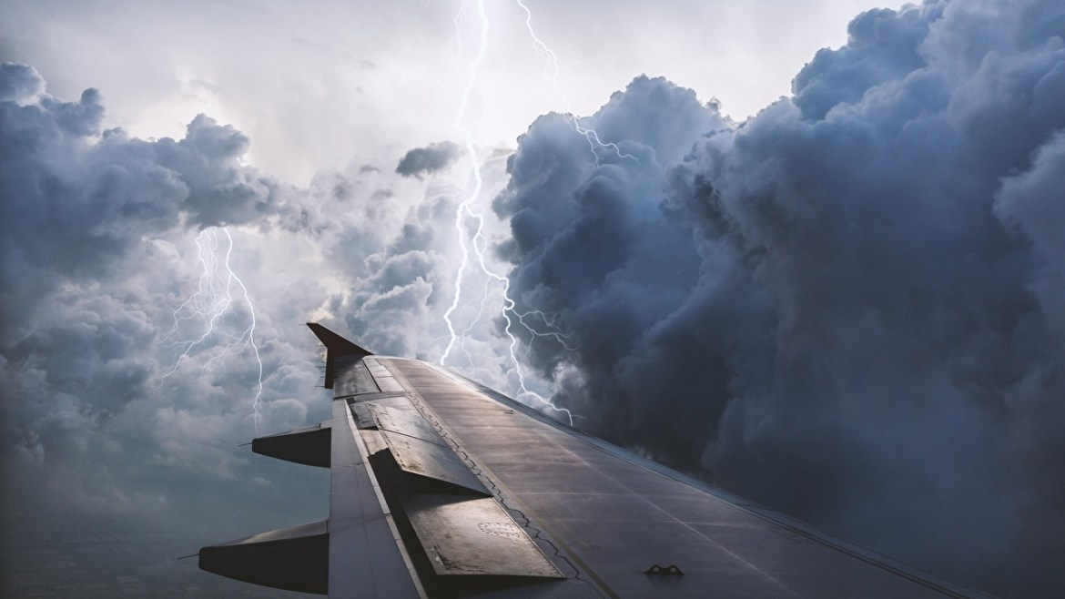 Aircraft_wing_Lightning_Clouds_Thundercloud_572358_1280x720