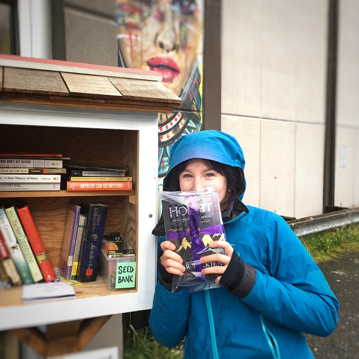 Dropping off a book at a Little Free Library