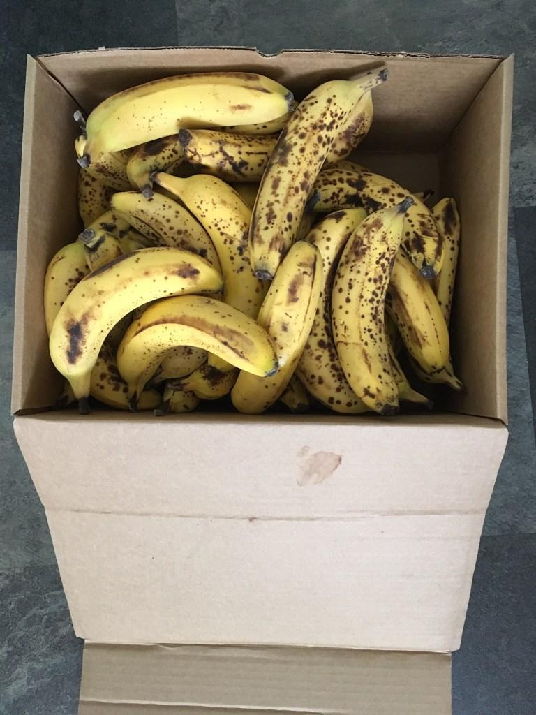 Box of ripe bananas