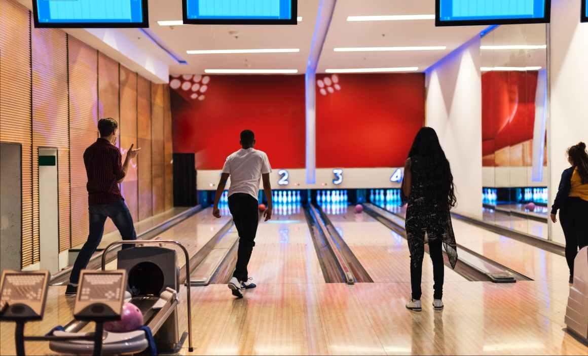 men and women playing bowling