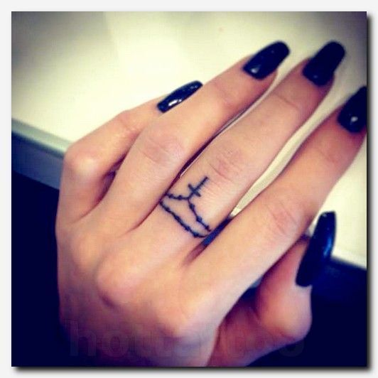 cross tattoo on finger