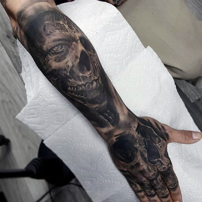 man-with-skull-and-zombies-lower-forearm-tattoo-sleeves