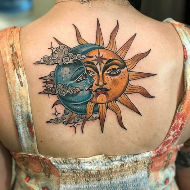 Stylized-blue-moon-and-yellow-sun-tattoo-on-the-upper-back