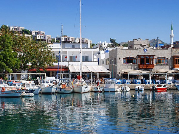 The old fishing port in Yalikavak showing a few restaurants with sea views