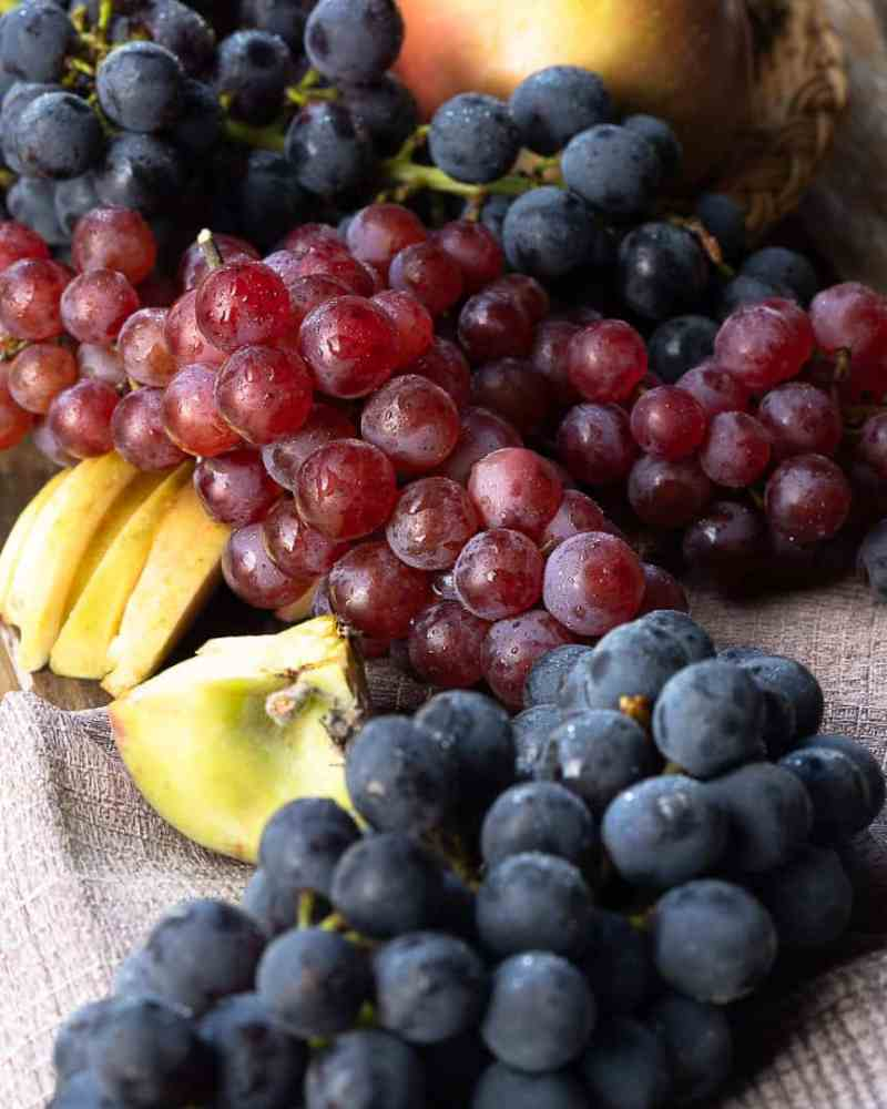 bunch of grapes on a wooden table