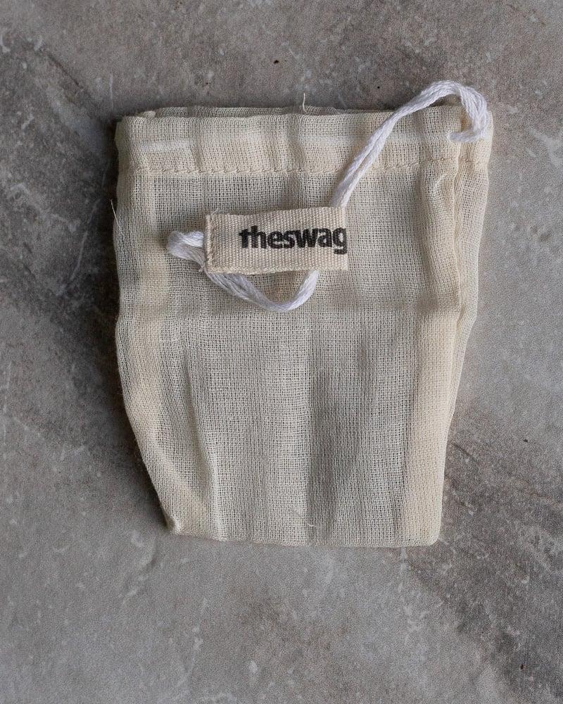reusable cloth tea bag on a white table