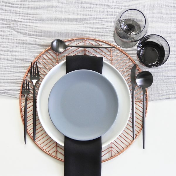 A Table to Love, tableware rental mixing copper chargers, slate blue and black. Modern dinner party ideas.