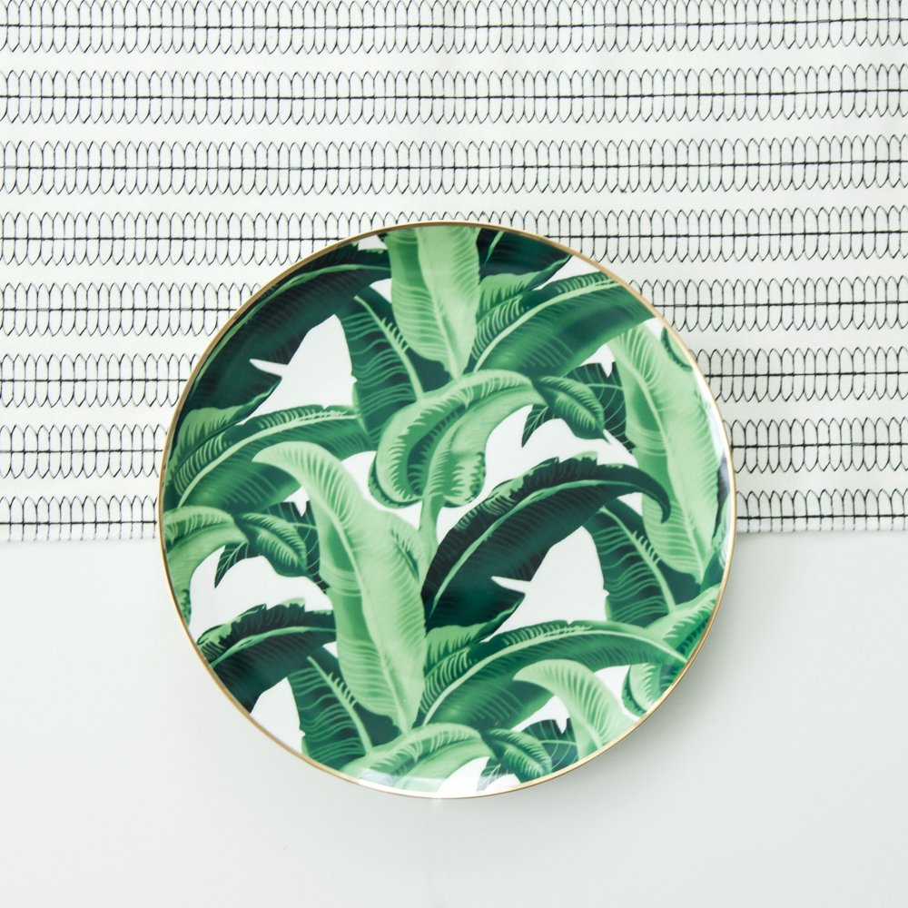 A Table to Love, black and white table runner with palm leaf charger plate