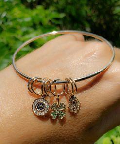 Bracelete Proteção com pingentes de Olho Grego, Trevo de zircônia verde e Mão de Hamsa com micro zircônia branca em banho de ouro 18k