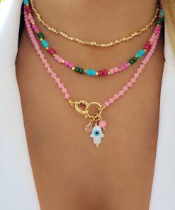 Colar 47cm com Murano Rosa Claro e Patuá com Mão de Hamsa de madrepérola e olho grego com zircônia rosa claro em banho de ouro 18k