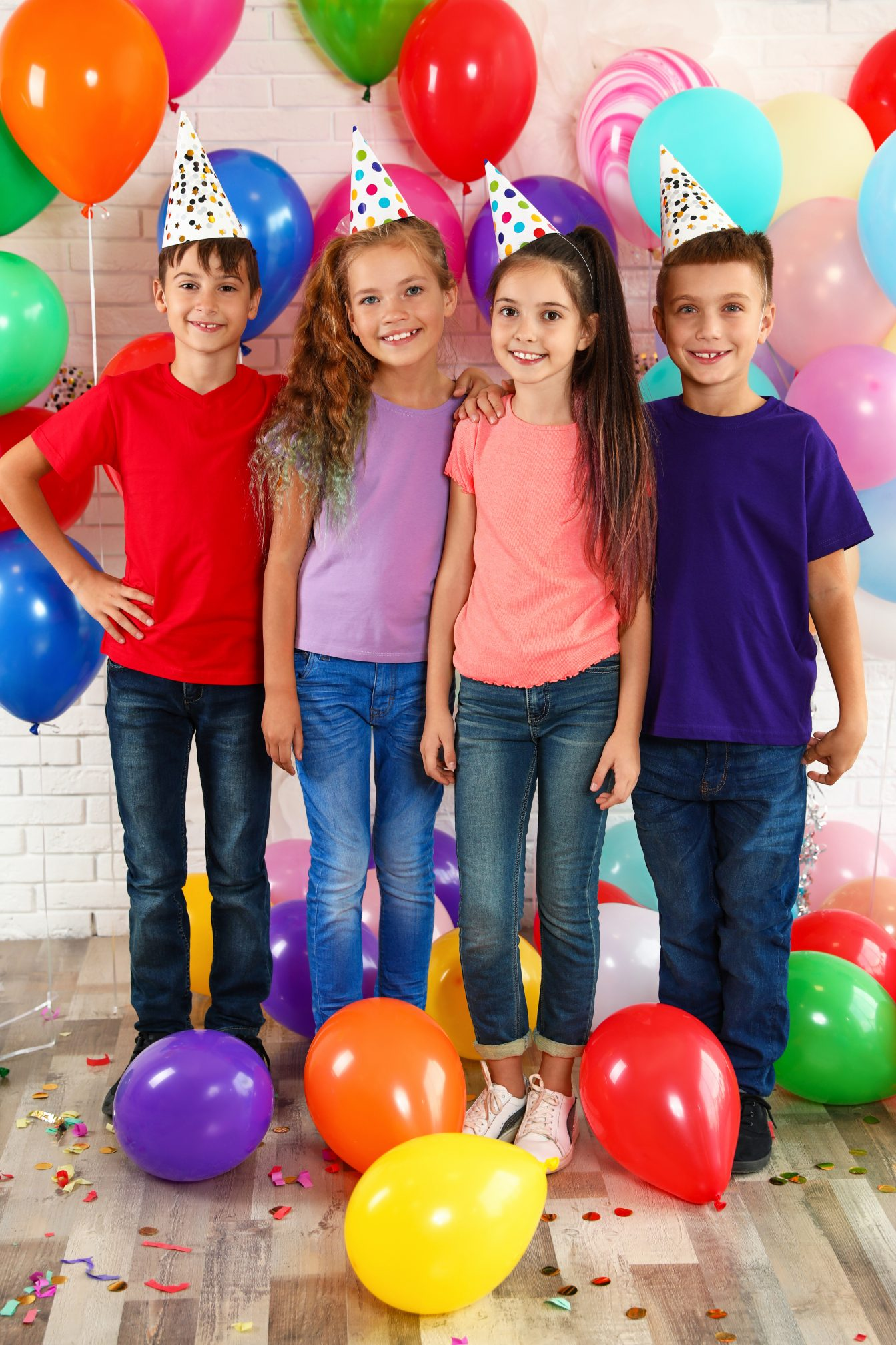 Happy children near bright balloons at birthday party indoors