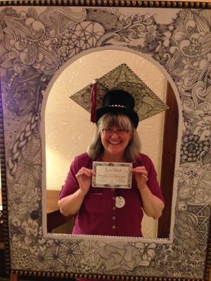 Photo of Lynn Mead at her graduation as a Certified Zentangle Teacher.