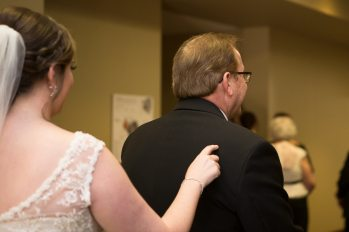 First look between the bride and her dad.