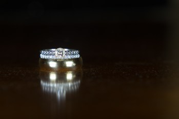 Wedding Rings photographed atop a reflective surface.