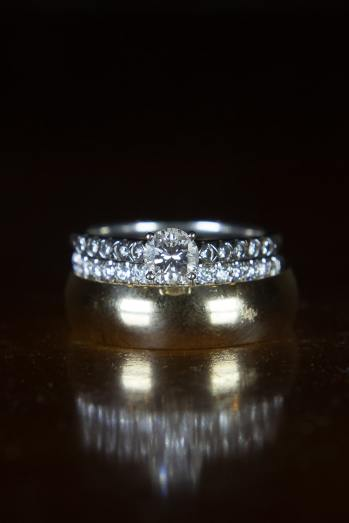 The double eternity bands highlight the gorgeous diamond solitaire in the brides gold wedding ring set.