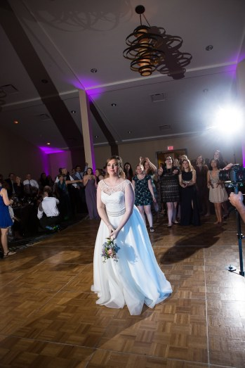 Bouquet toss by the bride at The Woodlands Resort.