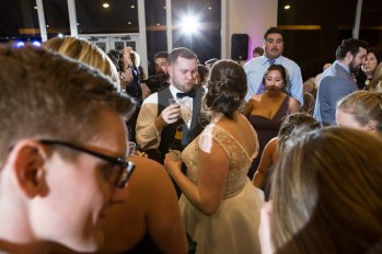 Bride and Groom enjoying the party atmosphere at their Woodlands, TX wedding.