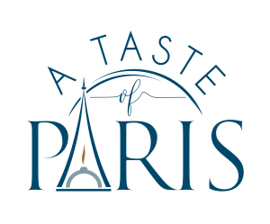 A Taste of Paris Logo in Blue font with the Eiffel Tower