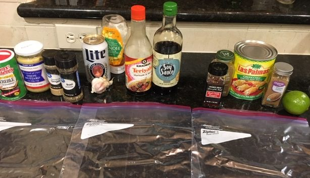 Variouls Spices for Chicken Marinde including soy sauce, miller lite, green chile's
